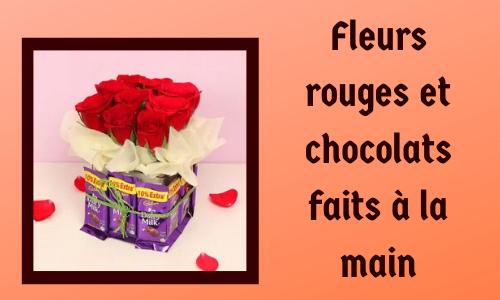 Fleurs rouges et chocolats faits à la main